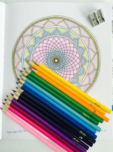 Getting started, these are the Colored pencils, sharpener, and the first picture I colored called the Copper Circle.